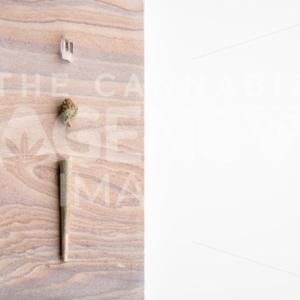 Marijuana Bud, Joint and Crystal on a Desert Stone, Landscape Orientation – Minimalist Cannabis - The Cannabiz Agency